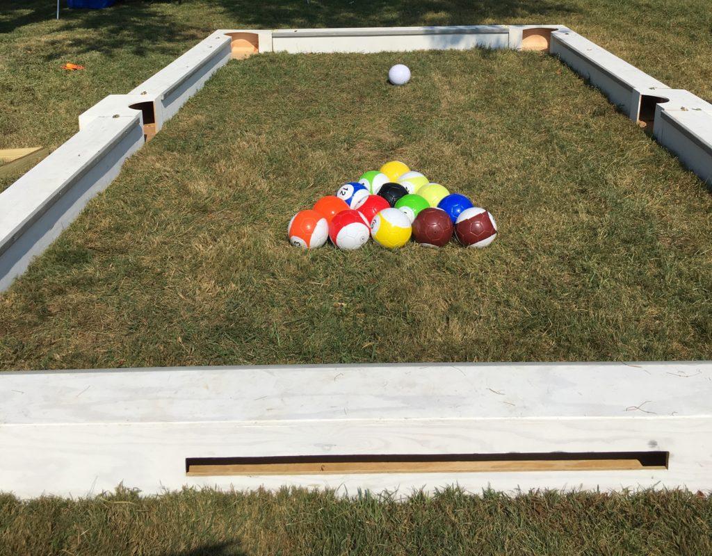 Soccer billiards set up on grass
