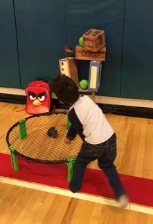 Kid throwing angry birds at trampoline game