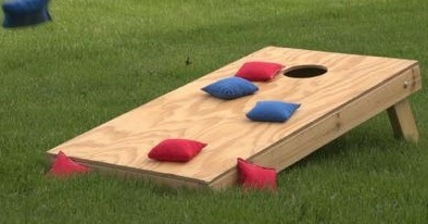 Bean Bags on a Bean Bag Toss board on the grass