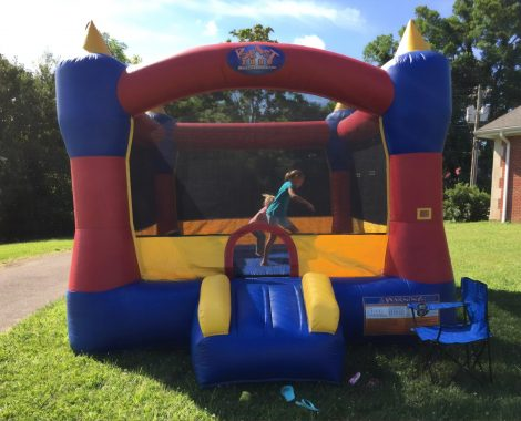 Kids bouncing in a castle bounce house